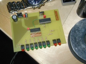 A PIC16F84A sitting on the self-etched controller board